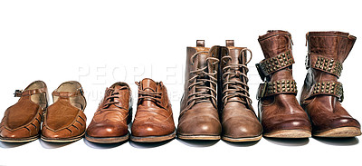 Buy stock photo Shot of a selection of shoes lined up together