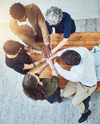 Buy stock photo High angle shot of a group of unrecognizable businesspeople putting their hands in a huddle