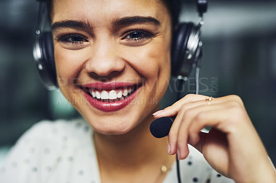 Buy stock photo Portrait of a young call centre agent working late in an office