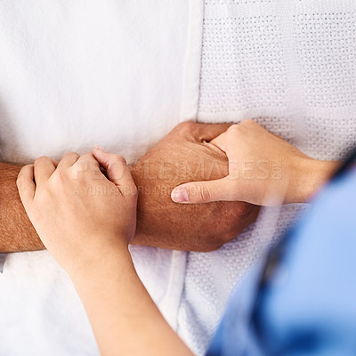 Buy stock photo Closeup of a unrecognisable person's hand being held by a doctor inside a medical clinic