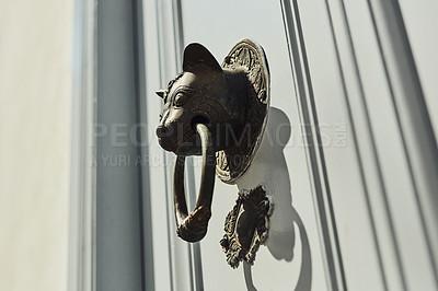 Buy stock photo Cropped shot of a door knocker on a wooden door