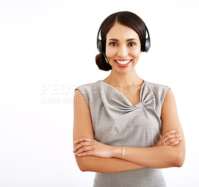 Buy stock photo Studio shot of an attractive young woman wearing a headset against a white background