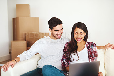 Buy stock photo Cropped shot of an affectionate young couple relaxing with their laptop on the sofa at home