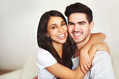 Buy stock photo Cropped portrait of an affectionate young couple relaxing on the sofa at home