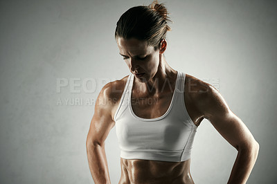 Buy stock photo Studio shot of an athletic young sportswoman posing against a grey background