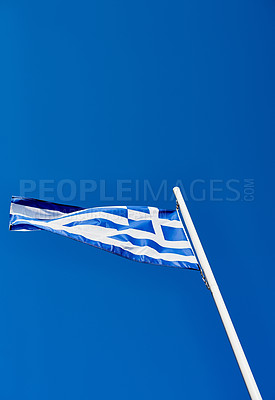 Buy stock photo Low angle shot of the Greek flag standing on its own outside during the day