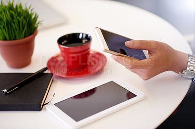 Buy stock photo Closeup shot of an unidentifiable businesswoman using a cellphone in an office