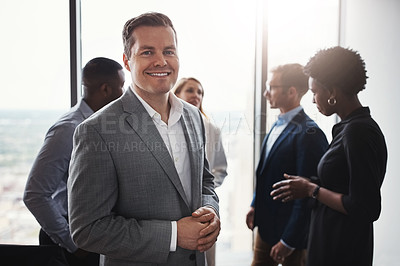 Buy stock photo Cropped portrait of a handsome businessman standing in the boardroom during a meeting