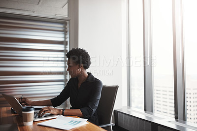 Buy stock photo Cropped shot of an attractive businesswoman working in her corporate office