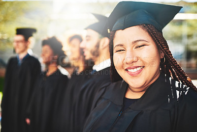 Buy stock photo Portrait of a smiling university student on graduation day with classmates in the background