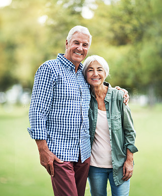 Buy stock photo Shot of an affectionate senior couple spending a day in the park