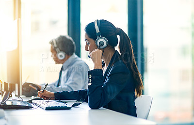 Buy stock photo Cropped shot of two customer service representatives at work in their office