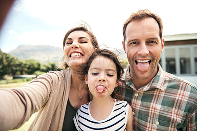 Buy stock photo Cropped shot of a family of three taking a selfie