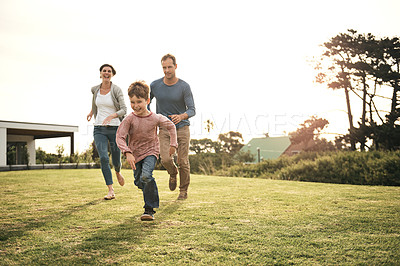 Buy stock photo Shot of a family of three spending quality time together