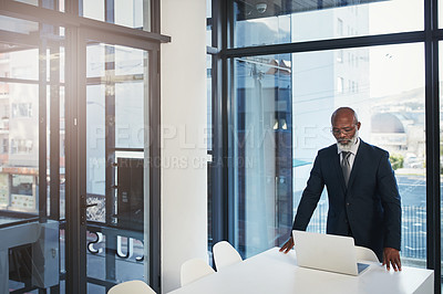 Buy stock photo Cropped shot of a mature businessman working in a modern office