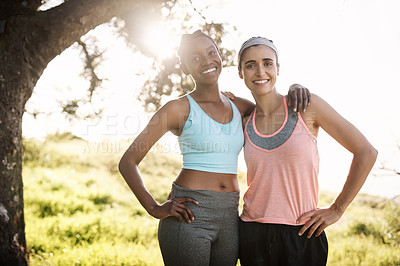 Buy stock photo Shot of two friends out exercising together