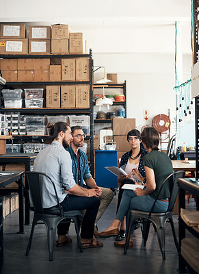 Buy stock photo Shot of a group of colleagues having a discussion in a workshop