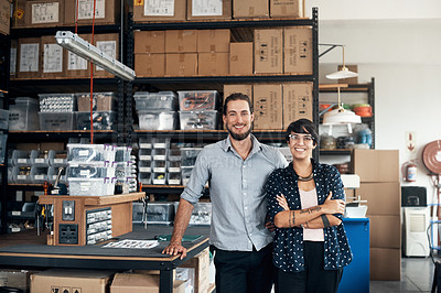 Buy stock photo Portrait of two colleagues standing in a workshop