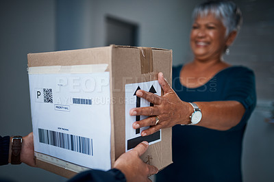 Buy stock photo Cropped shot of a package being delivered to a senior woman