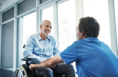 Buy stock photo Shot of a senior patient being cared for by a male nurse