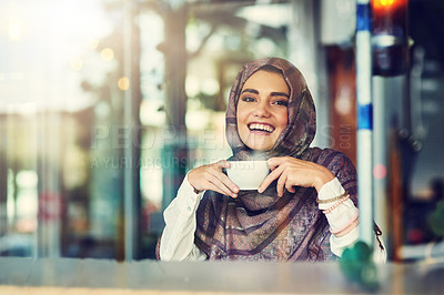 Buy stock photo Portrait of a young woman having a cup of coffee in a cafe