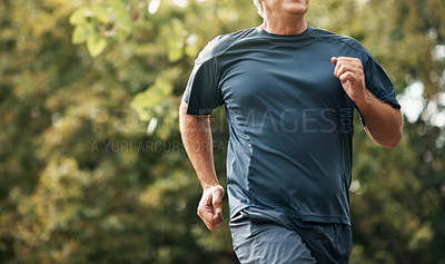Buy stock photo Cropped shot of a senior man out for a run in the park