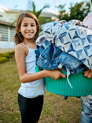 Buy stock photo Portrait of a mother and daughter hanging up laundry together outside