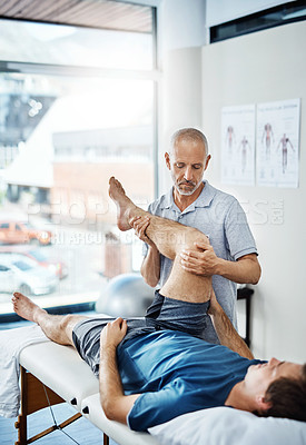 Buy stock photo Shot of a physiotherapist treating a patient