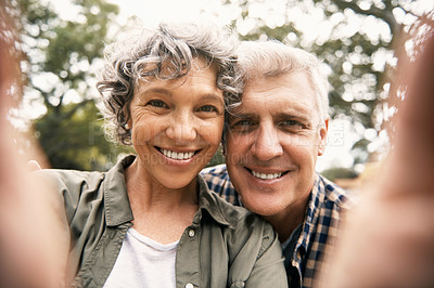 Buy stock photo Portrait of a happy senior couple taking selfies together in the park