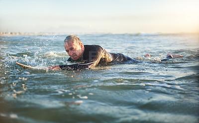 Buy stock photo Shot of a senior man surfing