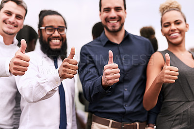 Buy stock photo Portrait of a group of businesspeople showing thumbs up together