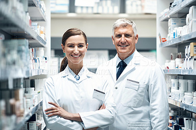 Buy stock photo Cropped portrait of two pharmacists working together in a dispensary