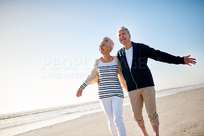 Buy stock photo Shot of a senior married couple spending a day at the beach