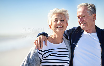 Buy stock photo Portrait of a happy senior couple spending a day at the beach