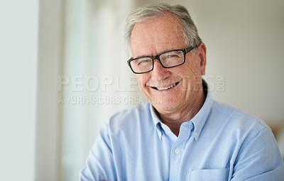 Buy stock photo Shot of a happy senior man at home