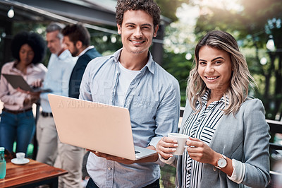 Buy stock photo Portrait of two businesspeople working together on a laptop outdoors