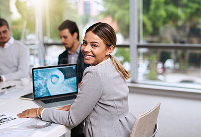 Buy stock photo Portrait of a young businesswoman having a meeting with her colleagues in an office