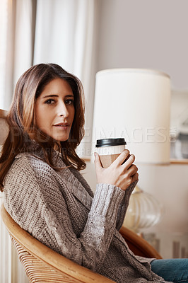 Buy stock photo Portrait of an attractive young woman relaxing at home with a cup of coffee