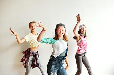 Buy stock photo Shot of young girls dancing in a dance studio