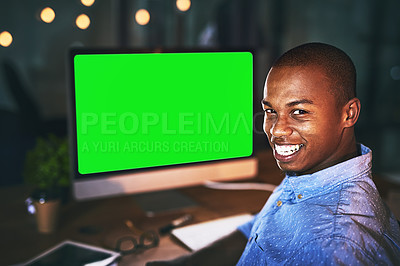 Buy stock photo Shot of a young businessman using a computer with a green screen during a late night in a modern office