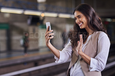Buy stock photo Cropped shot of a young attractive woman video calling with her cellphone while commuting with the train