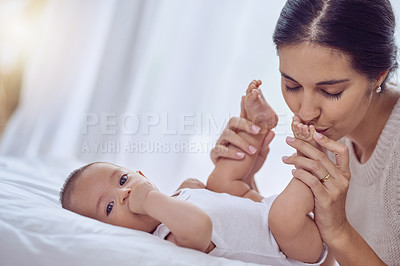 Buy stock photo Shot of a young woman bonding with her baby boy at home