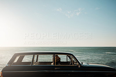 Buy stock photo Shot of a young woman going on a road trip along the coast