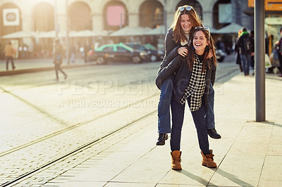 Buy stock photo Full length portrait of two attractive young women spending a day in the city