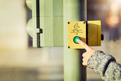 Buy stock photo Closeup shot of an unrecognizable woman pressing a button at a cross walk
