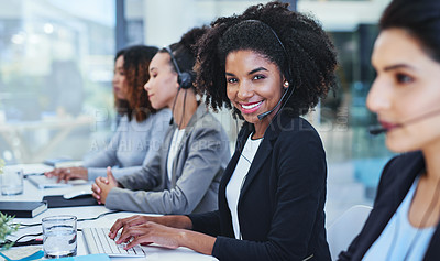 Buy stock photo Portrait of a young woman working in a call centre alongside her colleagues