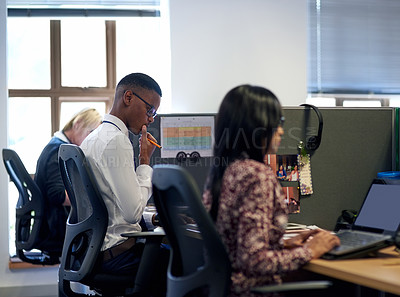 Buy stock photo Shot of businesspeople working in an office