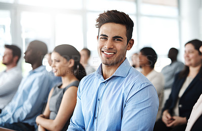 Buy stock photo Cropped portrait of a handsome young businessman sitting in a lecture room during a seminar