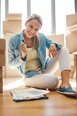 Buy stock photo Portrait of a mature woman going through paperwork on moving day