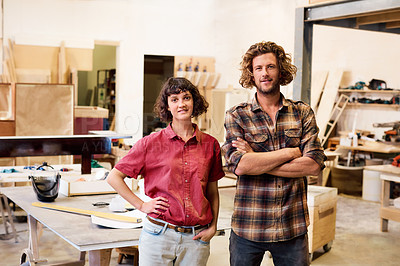 Buy stock photo Cropped shot of colleagues standing in a furniture manufacturing workshop